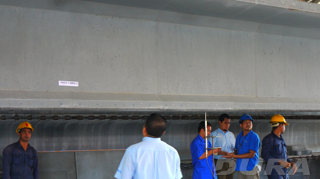Ikram representative having a detail inspection and labelling of the prototype DURA post-tension beam.